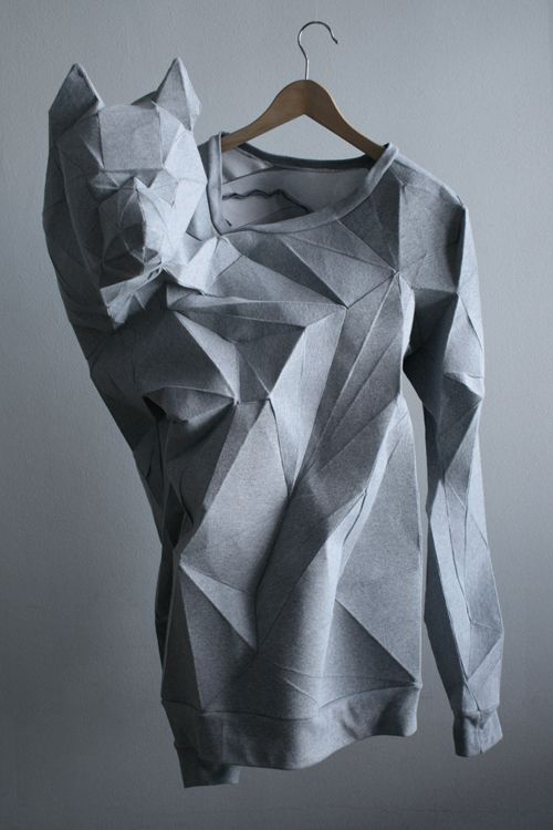 "Wolf shoulder/arm extension. ""Taking wearable art to a whole new level, Berlin-based Mashallah Design & Linda Kostowski created this 3-D sweatshirt by scanning human bodies and using the data to create sewing patterns. The human form is turned into 3D patterns of polygons, which are then turned into 2D files and used to laser cut fabric."""