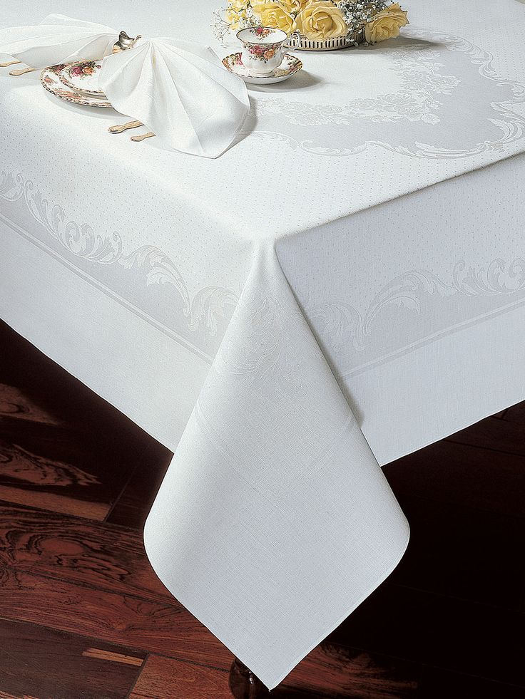 Floral Essence - #Luxury Table Cloths -Formal dining and entertaining enchants and impresses friends, filling the host with pride and pleasure. Floral damask #tablecloths and #napkins are underlined with subtle pin dots reflecting ultimate sophistication to ensure that every dining affair is a complete success. Imported from Czechoslovakia of 100% pure #linen for great durability and lasting beauty. Available in White.