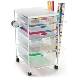 Unless you have the luxury of having a gift wrap/craft room, the White elfa Mesh Gift Wrap Cart is the best $200 you'll ever spend!  I've had mine for years and recommend it to all my clients.  I keep mine in the guestroom closet.  Pull out when there's a gift to wrap or mail, and wheel into another room when guests are staying!  Also, its size helps you to keep gift wrap supplies to a minimum!