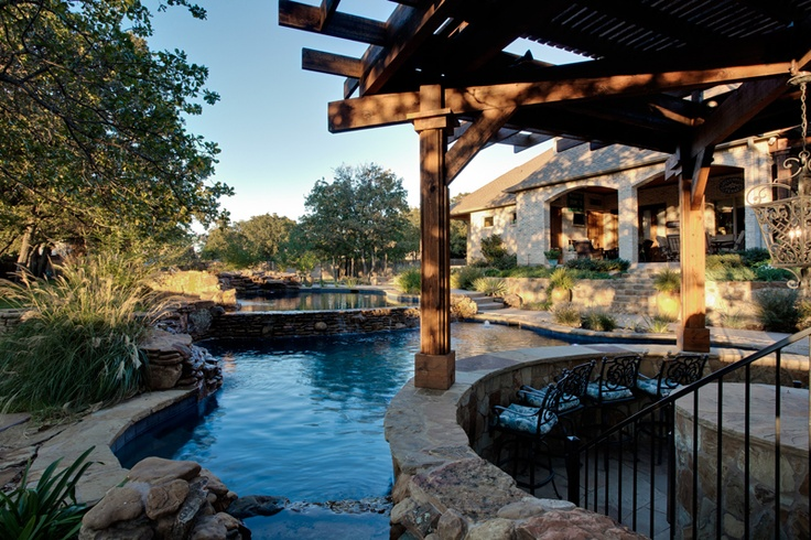 Custom swimming pool design and outdoor living area by one for Luxury pool area