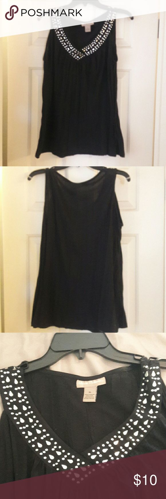 Womens top Black women's tank top with silver beading on neck line. Worn once. In great condition. Smoke free, pet free home Allyson Whitmore Tops Tank Tops