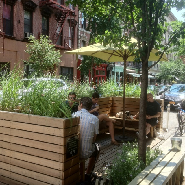 Community porches created in the city for a coffee shop.. Great idea and gives shade.