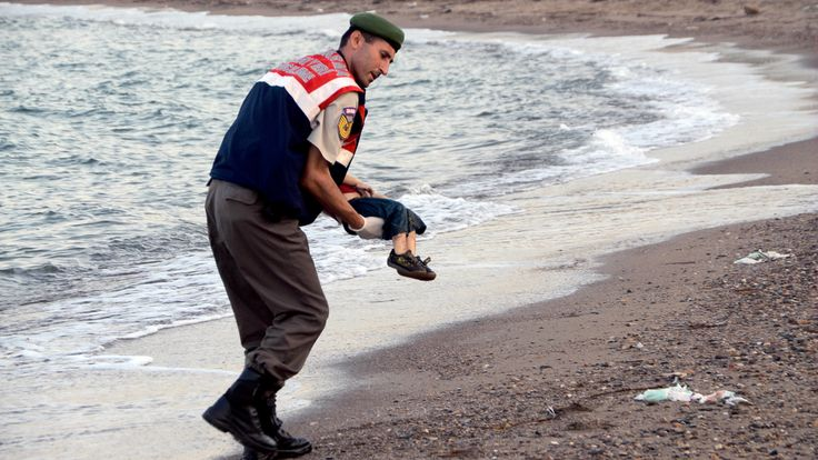 A police officer carries the body of 3-year-old Aylan Kurdi who drowned while making the dangerous journey across the Mediterranean Sea with his family. With winter coming, aid organizations are asking for extra assistance for refugees and migrants coming to Europe. Here's how you can help.