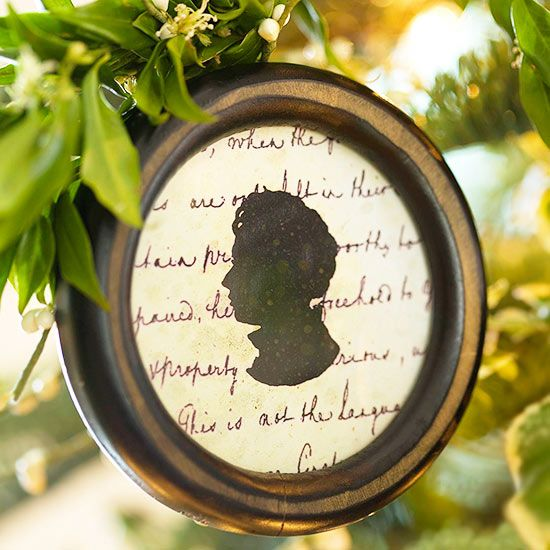 Using a photo as a guide, trace a silhouette onto black paper and cut it out. Line the back of a small frame with decorative paper, then glue the silhouette on top. Hang with a pretty ribbon.