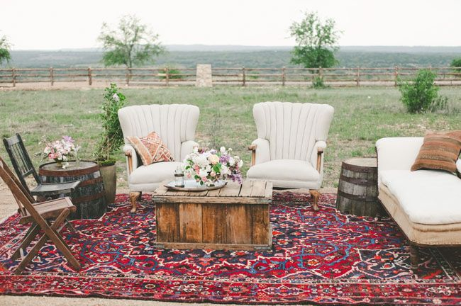 Cocktail lounge. Bohemian black tie wedding. muted pinks, lavenders, and ambers, dialed up with pops of richer berry tones. Perfect mix of boho + posh and ultra lush blooms. Photographer: The Nichols. Venue: family ranch in Dripping Springs, Texas