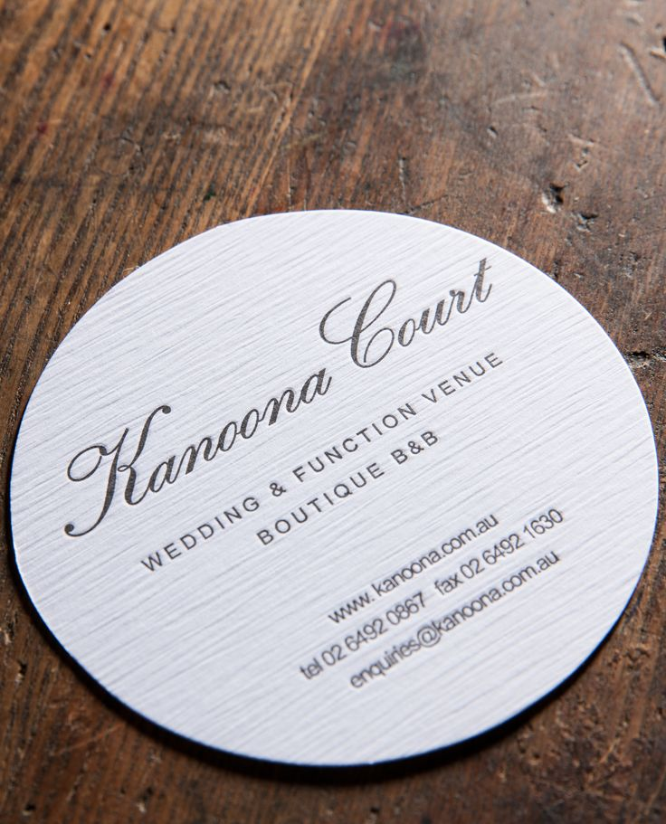 Circular letterpressed business cards for a regional boutique bed and breakfast
