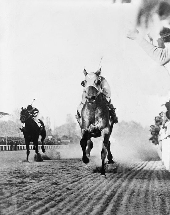 Seabiscuit acrossing the finish line, beating Triple Crown winner War Admiral at Pimlico race Course in Baltimore, Maryland. November 1, 1938. 40 million people listened to the race on the radio.