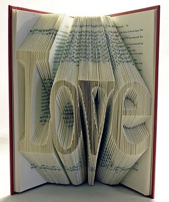 Inspiring words cut from the pages of an old book