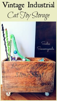"""I needed a better way to store pet toys while keeping with our vintage industrial / primitive home decor. So I took an antique wooden crate, added some salvaged casters / wheels, and built an inside """"pocket"""" to keep their toys neat and tidy. I love to organize with an upcycle / repurpose project! /search/?q=%23SadieSeasongoods&rs=hashtag"""