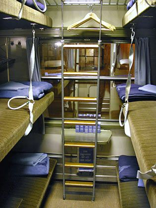 The interior of typical European couchette compartment, with the beds folded down to the night-time configuration.