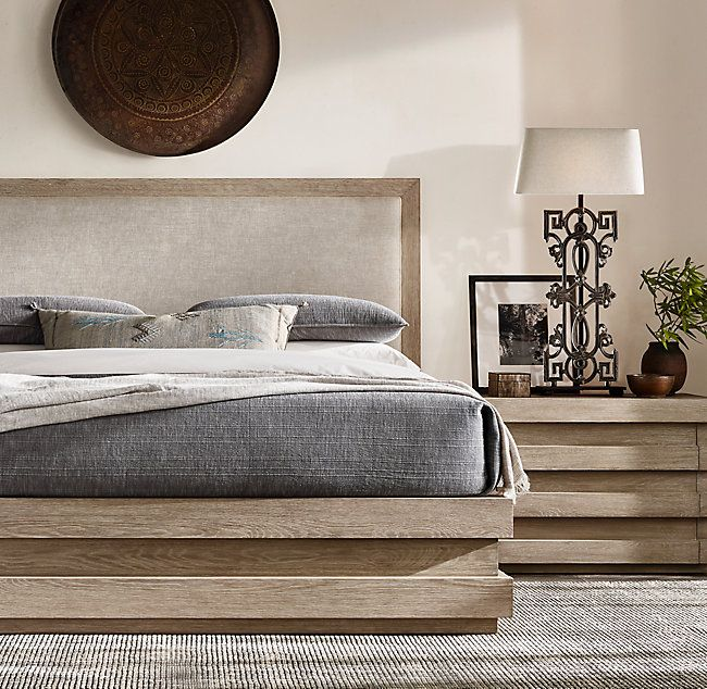 RH's Stacked Storage Bed:Designed by the Van Thiels, our collection recalls the bold architectural geometry of the 1970s Brutalist movement. Handcrafted of rich, open-grain oak, our clean-lined storage bed features a base with a stepped motif, creating a subtle sense of movement and poetic repetition within the solid silhouette.SHOP THE ENTIRE COLLECTION ▸