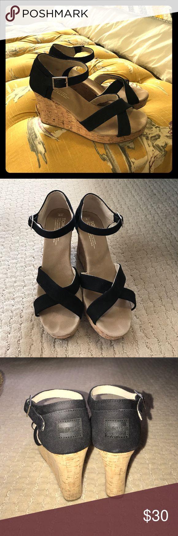 Toms black cork wedges Adorable black wedges. Gently used. 1 inch platform and 4 inch heel Toms Shoes Wedges