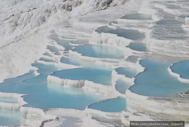 """Pamukkale is open to the public and people are welcome to walk over the travertine terraces. The only restriction is that visitors must first remove their footwear – the site's guardians making the (often incorrect) assumption that tourists' feet will be cleaner than their flip flops."""