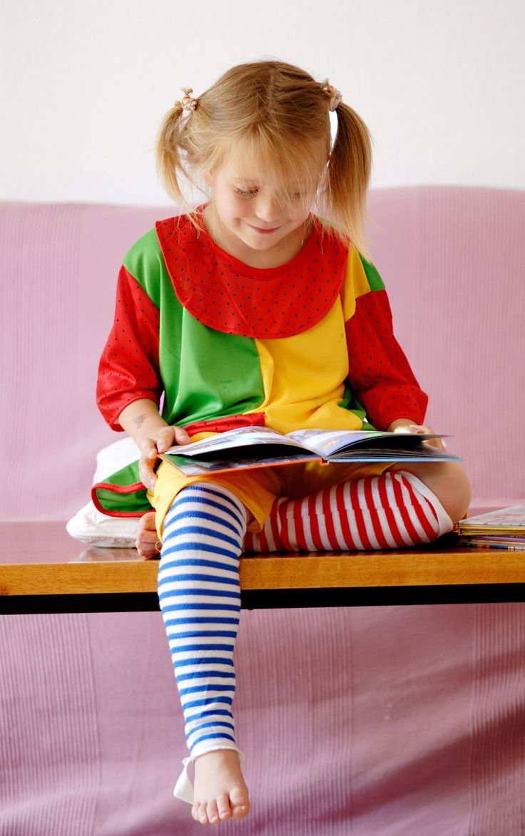 little girl reading a book of fairy tales - little girl reading a book of fairy tales