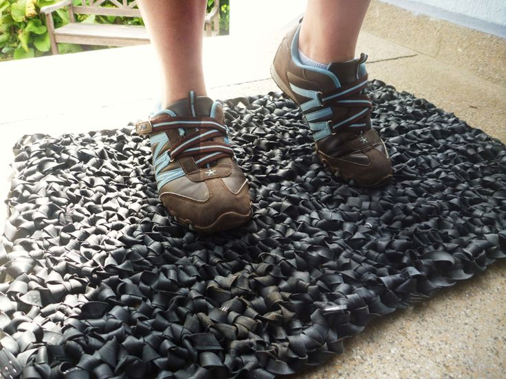 """""""I crocheted this door mat out of old, broken bicycle tubes. After several attempts I found out that it's the easiest way to use a tent peg. I cut out the valves and then slit the tubes lengthwise. Washing the tubes has to be done thoroughly because the valves are covered in a thick layer of powdered talc from the inside. Then you have to cut the tubes in stripes and either tack (like I did it) or sew them together. The result is a long """"thread"""" which you just crochet and then you're done."""""""