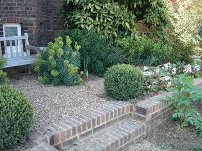 A corner of a garden I designed in Wimbledon some years ago.  From the little garden seat you look down onto an Herb Garden
