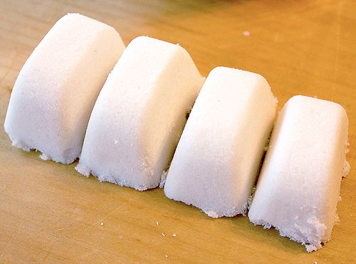 dishwasher tabs: 2 cups Washing soda 2 cups Borax  1/2 cup Kosher salt or Epsom salt (reduces the effects of hard water) 1/2 cup vinegar 15-20 drops of Lemon essential oil  Mix together, press into ice cube trays (makes 2 trays worth) let dry 24hrs, then store in a sealable glass container. use one per load, with 1/2-1cup white vinegar in bottom of dishwasher (for hard water)