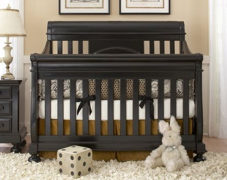 gorgeous black crib with intricate prints and crisp white. so classic.