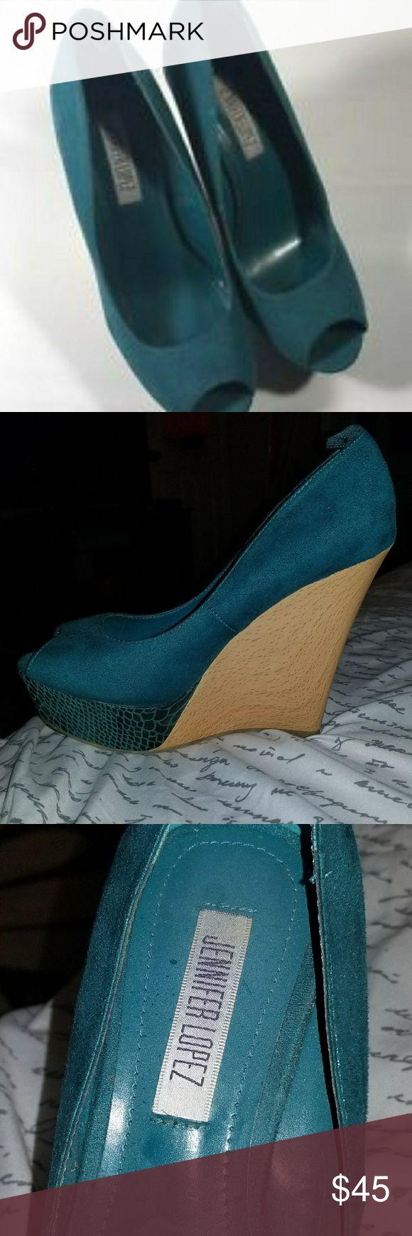 Jennifer Lopez - Turquoise Wedges Jennifer Lopez - Turquoise Wedges  Only worn once Missing turquoise ankle straps Jennifer Lopez Shoes Wedges