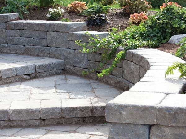 Building A Retaining Wall That U201csteps Upu201d The Slope Is An Easy Way To  Create More Usable Space And Enhance The Look And Feel Of Your Landscape.
