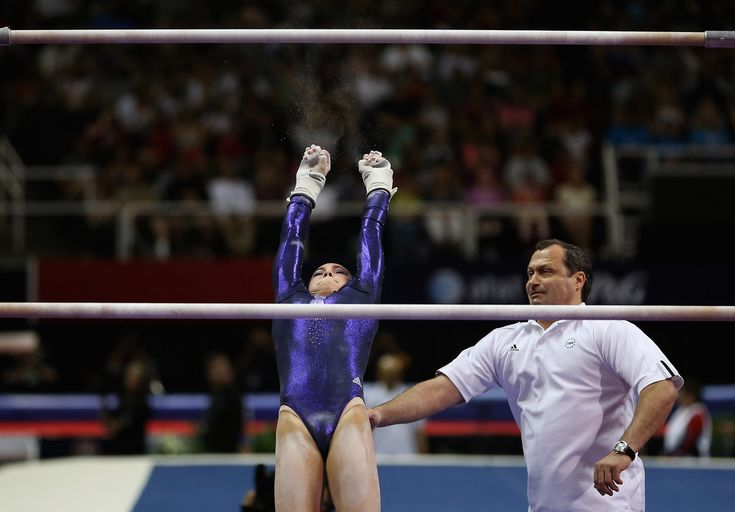 McKayla Maroney Photos Photos - McKayla Maroney falls off the uneven bars as her coach Arthur Akopyian tries to spot her during day 2 of the 2012 U.S. Olympic Gymnastics Team Trials at HP Pavilion on June 29, 2012 in San Jose, California. - 2012 U.S. Olympic Gymnastics Team Trials - Day 2