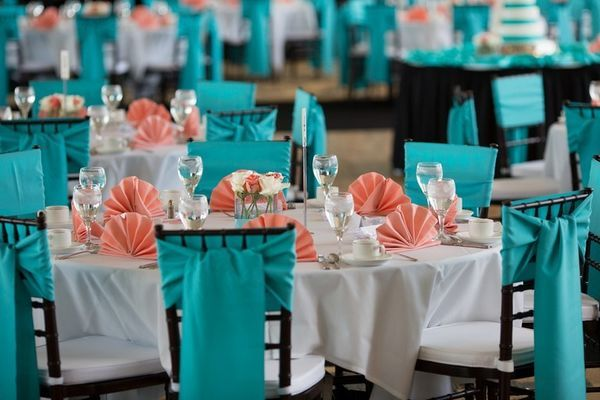 The most popular color pairing for a teal wedding is coral. This peppy blend has been used at countless beach weddings and sets a cheerful mood.