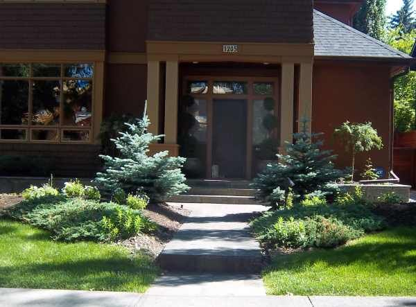 A Small Front Yard Walkway With Symetrically Balanced Low Maintenance Beds.  The Use Of Balance