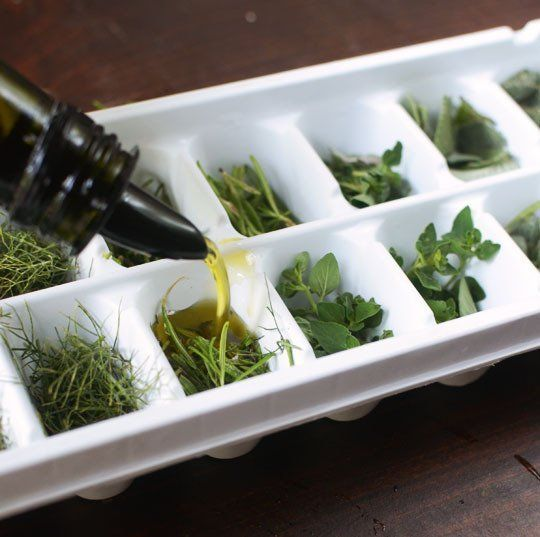 8 Steps for Freezing Herbs in Oil If you wish, you can chop them fine. Or leave them in larger sprigs and leaves. Here I froze a combination of finely-chopped and whole herbs such as rosemary, fennel stalk, sage, and oregano. Pack the wells of ice cube trays about 2/3 full of herbs. Pour extra-virgin olive oil or melted, unsalted butter over the herbs. Cover lightly with plastic wrap and freeze overnight. Remove the frozen cubes and store in freezer containers or small bags.