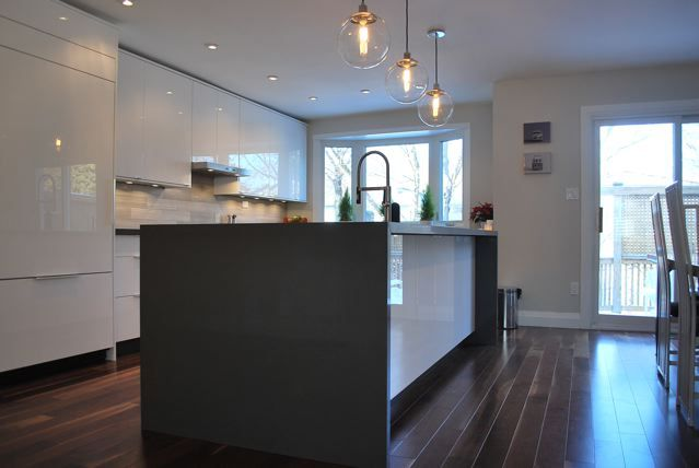 Ikea kitchen, layout,  waterfall island, glossy white, built in fridge.