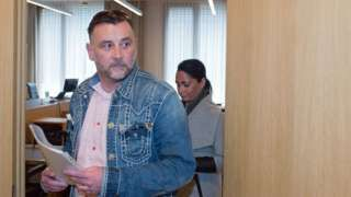 """Image copyright                  EPA                  Image caption                     Lutz Bachmann and his wife Vicky left the courtroom in Dresden together   The founder and leader of the German anti-Islam movement, Pegida, has been convicted of inciting racial hatred. Lutz Bachmann escaped a prison sentence but was fined €9,600 (£7,600; $11,000)  for calling refugees """"scum"""". Bachmann branded the case a political show trial. His lawyer sa"""