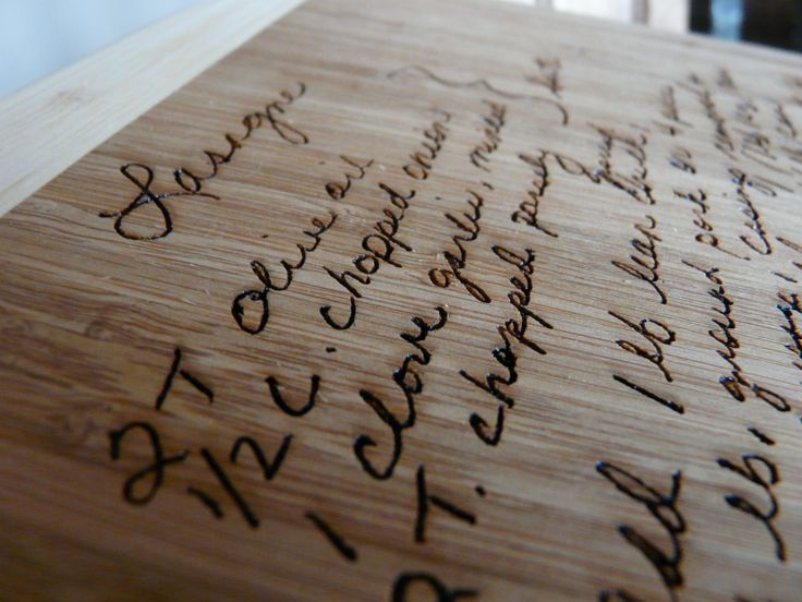 Closeup of deep engraving on bamboo cutting board with handwritten recipe created by Lazerworx.