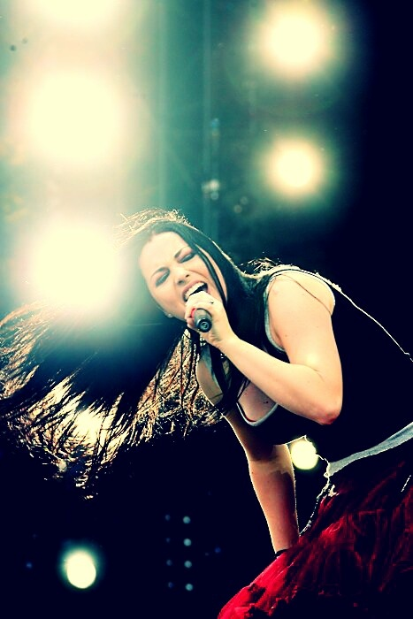 Amy Lee of Evanessence. Operatic vocals, beautiful tone and lyrics over epic metal riffs, and hot as hell to boot. What's not to love?