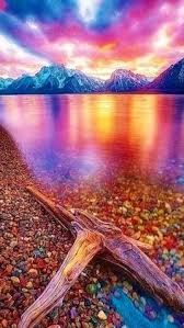 Sunset at lake mcdonald pebble shore montana