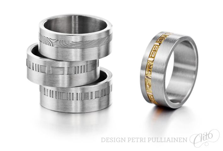 Set of stainless steel rings with Damascus stripe. Stainless steel ring with 750‰ gold laser engraved stripe. Photo Mikael Pettersson