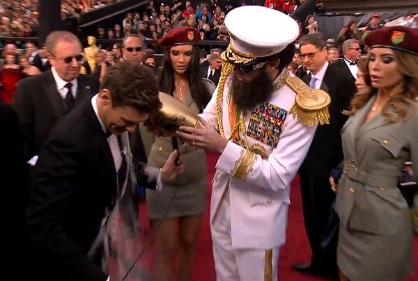 Sacha Baron Cohen, dressed as a Middle Eastern dictator, spills an urn of ashes over TV host Ryan Seacrest on the Oscars red carpet, 2012. We got a call to help create this urn, but declined.