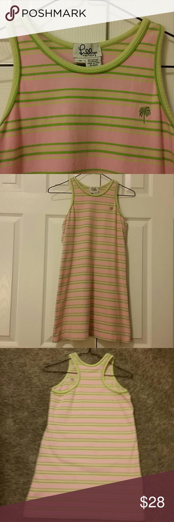 Vintage Lilly Pulitzer Sporty Girls  Tennis Dress Pretty pink racer back dress. Dark green and light green stripes. Green palm tree insignia on chest. Cotton and spandex. Size 12 girls. Lilly Pulitzer Dresses Casual