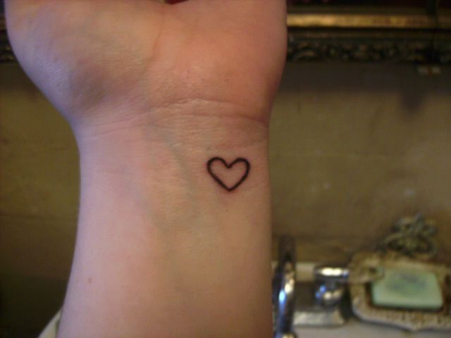 Heart wrist tattoo-- it would be really cute if you got a tatoo of your significant Other's hearts. Like however they draw a heart and have the tatoo artist do that instead of just a normal heart. More sentimental value.