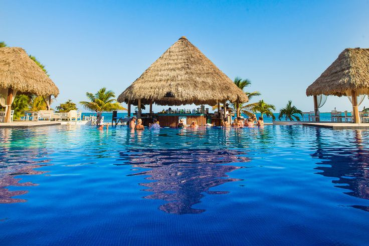 Belize Ocean Club Resort & Spa in Placencia on Maya Beach is a beautiful  hotel with many vacation packages. Family vacations, honeymoons, weddings  and all events. Largest pool in Belize and overwater spa. Each room is a  gorgeous suite with a beautiful view.