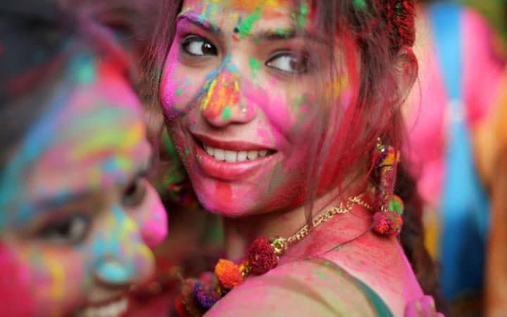 Students of the Rabindrabharati University apply coloured powder on each other as they celebrate the Holi festival at Tagore House in Calcutta, eastern India.