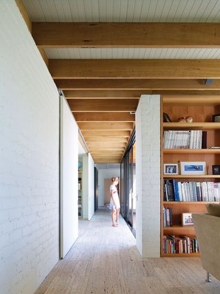 White-painted brick and wood create a handmade feel to the interior.