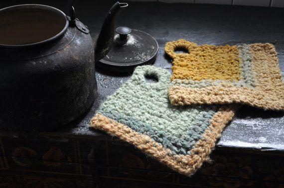 Hanging pair of pot holders in felted handspun wool