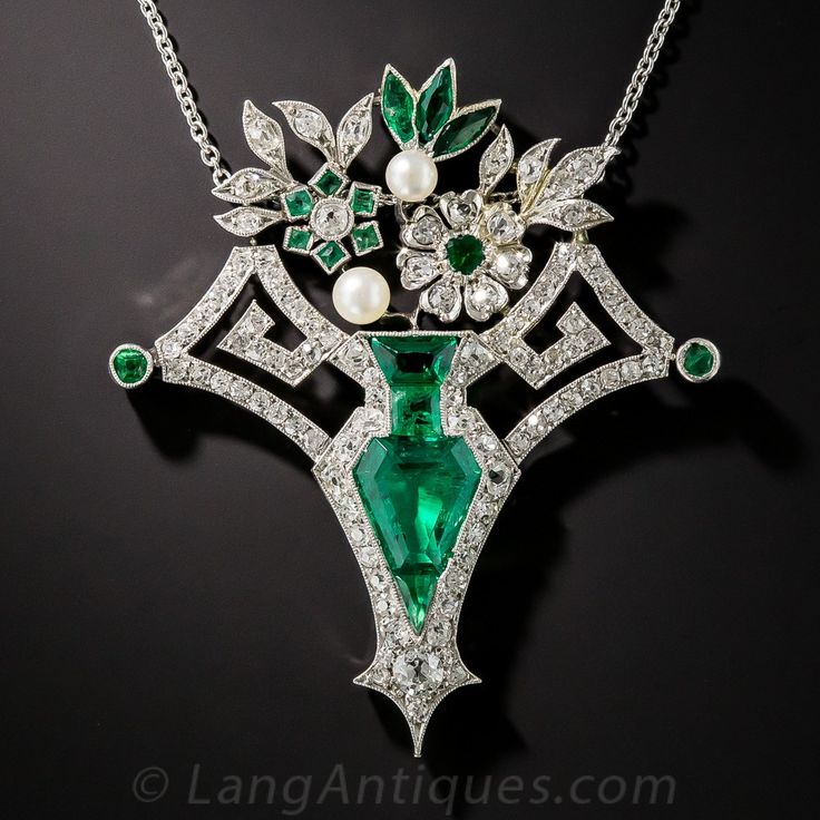 Art Deco Emerald and Diamond Flower Basket Necklace. A gemmy, richly saturated, crystalline green, kite-shape Colombian emerald, weighing 1.80 carats, along with three fancy-cut emeralds, form the breathtakingly beautiful centerpiece - a sleek amphora flower vase - in this fabulous late-Edwardian/early-Art Deco jewel delicately and expertly hand fabricated in platinum, circa 1915-25
