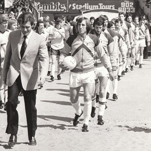 Manager John Lyall and captain Billy Bonds lead out the remaining West Ham players to face Arsenal in the 1980 FA Cup final at Wembley