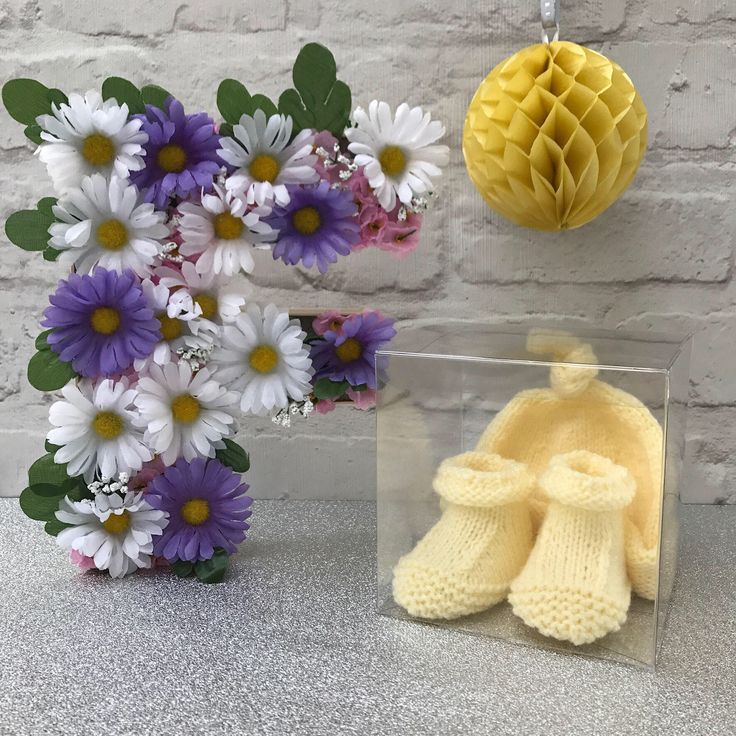 A personal favourite from my Etsy shop https://www.etsy.com/uk/listing/520994212/baby-hat-and-booties-gift-set-lemon