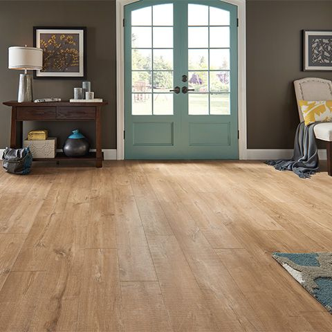Scottsdale Oak textured laminate floor. Light oak wood finish, 12mm 1-strip plank laminate flooring, easy to install and covered by PERGO's lifetime warranty.