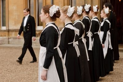 Image from Downton Abbey Season 1: Female servants line up to greet visitors © Carnival Film & Television Limited 2010 for MASTERPIECE