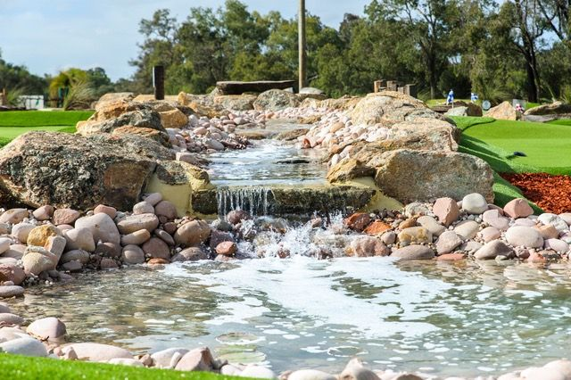 Our mini golf course designs can include stunning water features that will make the game feel more like real golf