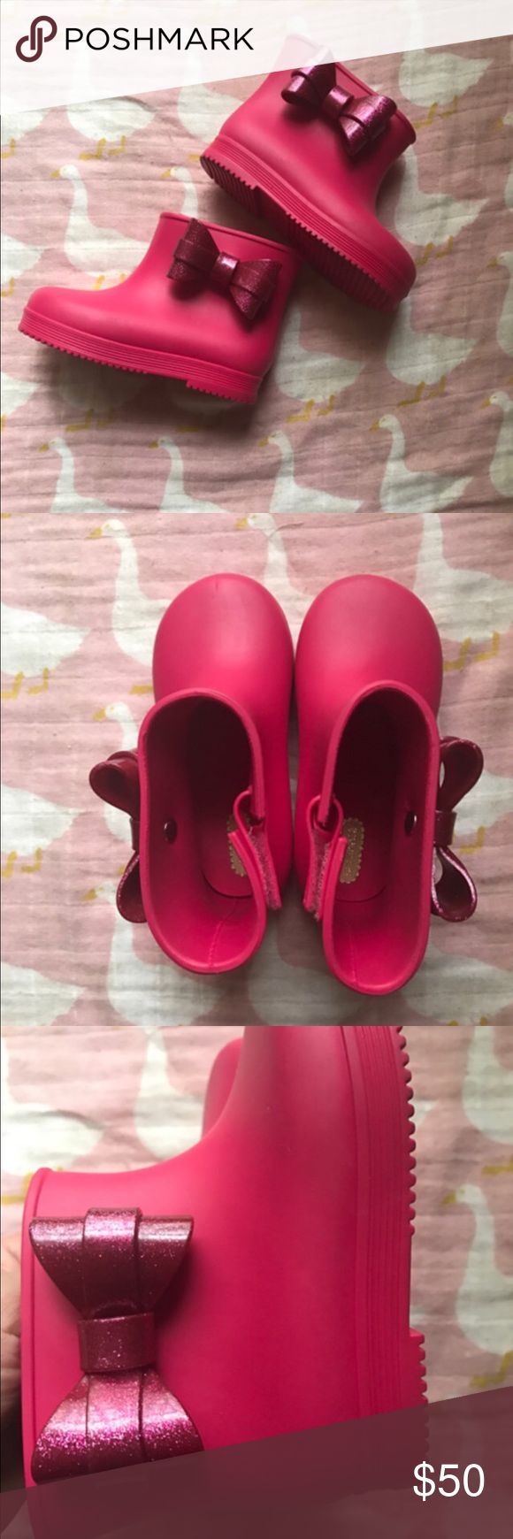 NWOT Mini Melissa pink rain boots From Nordstrom Rack- might have some mild signs of being tried on at store. Just available until they fit my Lolo. Perfect match to Boden Galaxy dress! Retail $65 Mini Melissa Shoes Boots