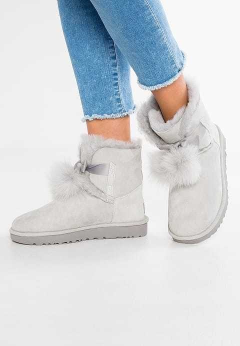 0f1062c48c8 UGG AUSTRALIA Boots Uggs Gita Pom Pom Bow Leather Shearling Booties ...