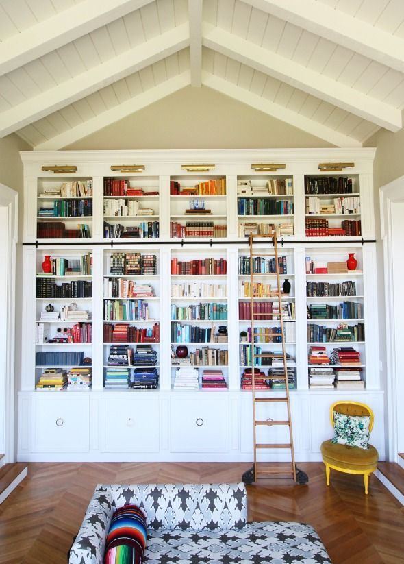 Really beautiful ceiling height bookshelf, saves space and includes added  lighting